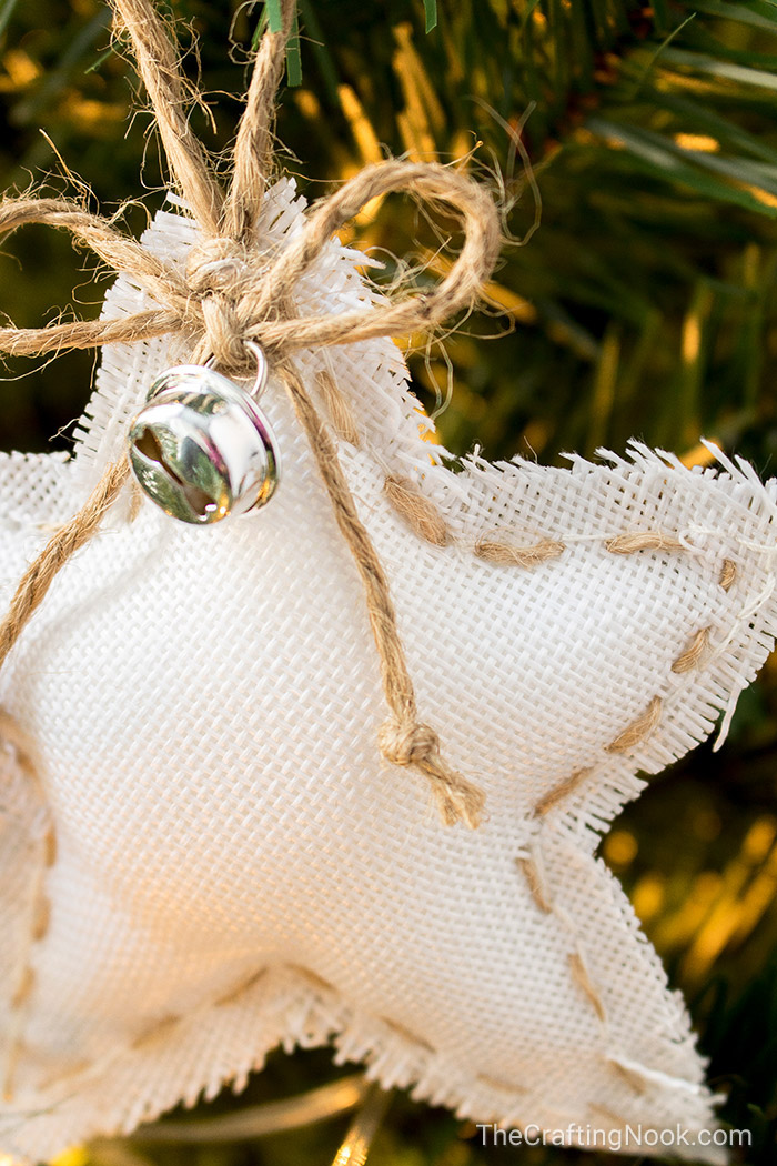 A closeup of the twine bow and jingle bell on the white star