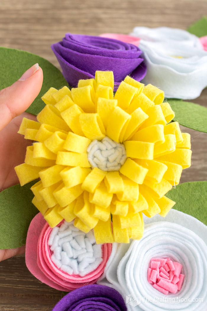 How to make easy and cute felt flowers the crafting nook by titicrafty would you like another way to make super cute flowers check out my friend karinas paper flowers mightylinksfo