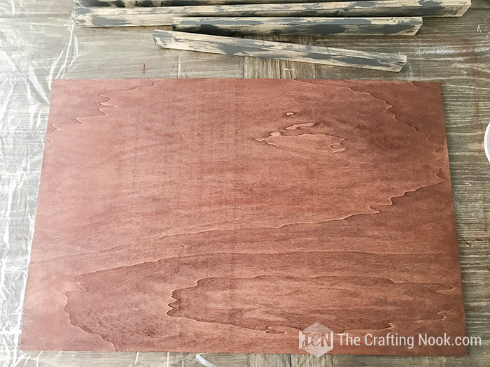 Wood board stained with walnut color.