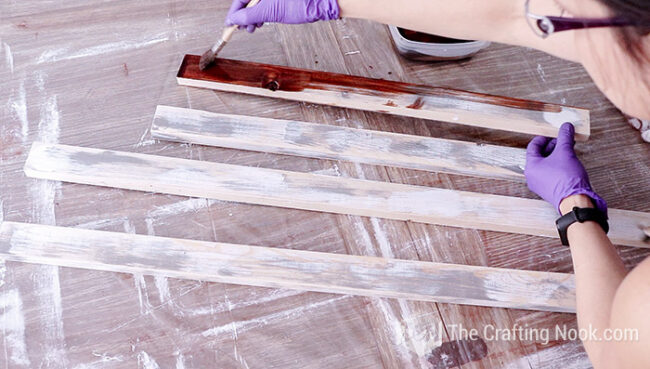 Stain the frame boards over the sanded frame boards