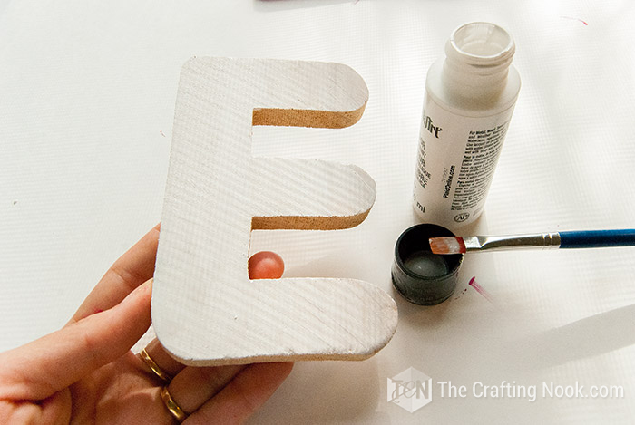 Then painted the E letter in white. On this one I had to add a second coat.