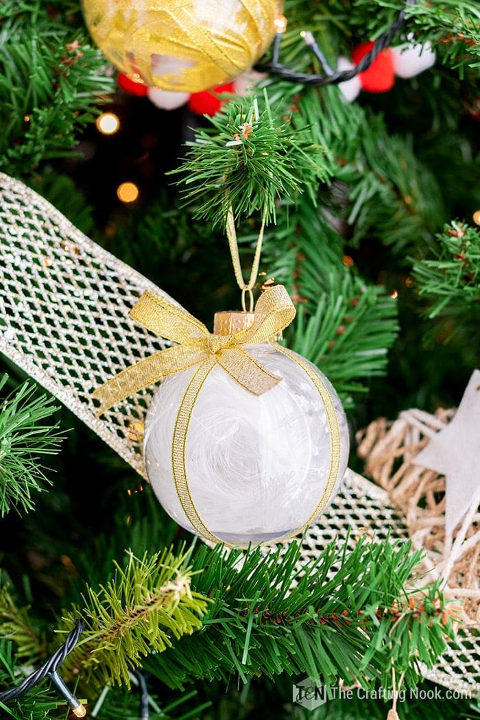 Feather Filled Ornament hung on the tree