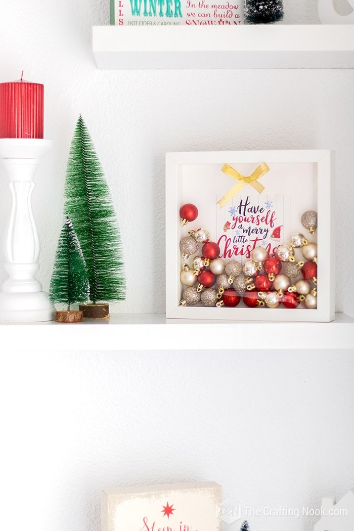 Red and Gold Ornaments Shadow Box on the shelf