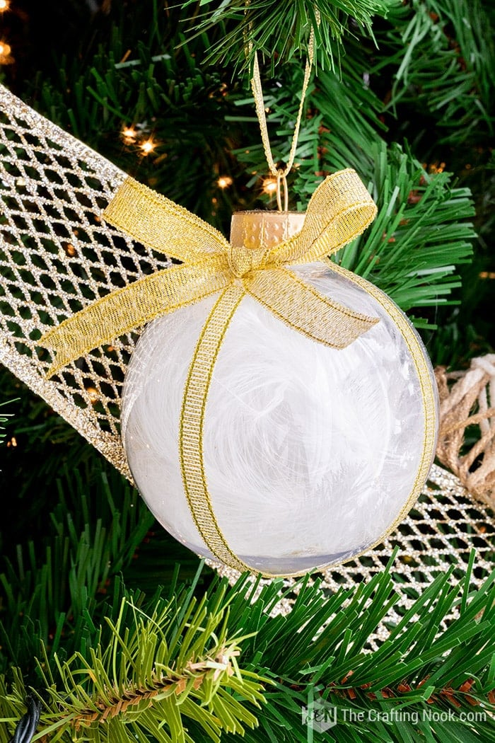 Feather Ornament with gold ribbon and a ribbon bow.