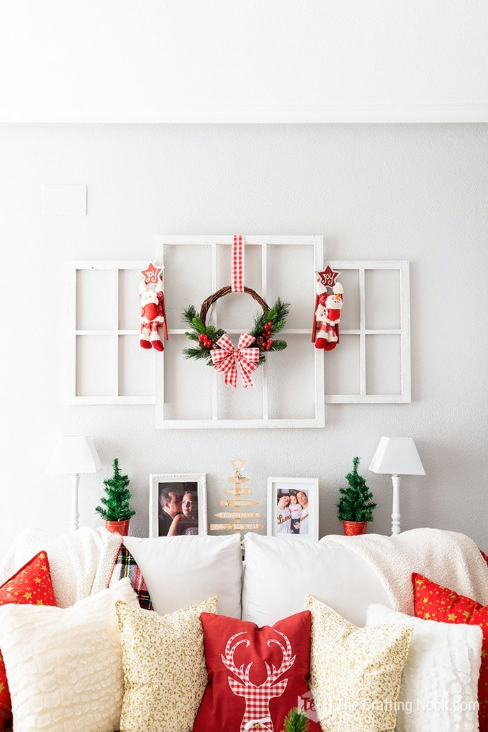 Living Room decorated with a Red and Christmas Wreath
