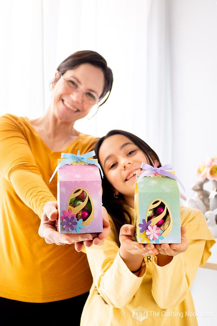 My daughter and I showing how the cute Easter favor boxes turned out