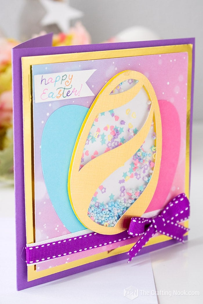 Super cute Easter card with a shaper filled with colorful beads and confetti.