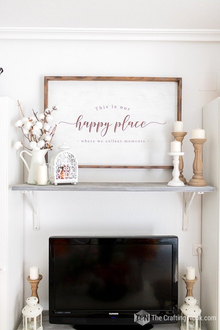 Rustic wood sign on the wall with Our Happy place sentiment.