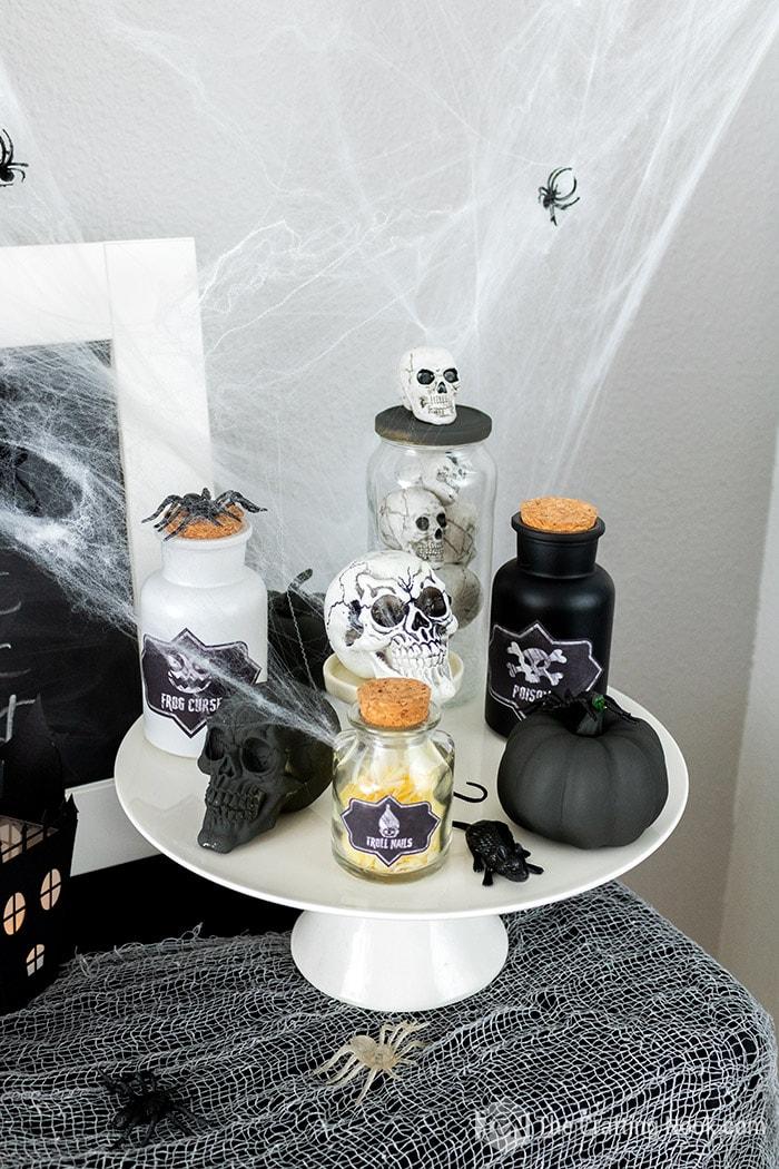 Skulls, black pumpkins and potion bottles Halloween Decor