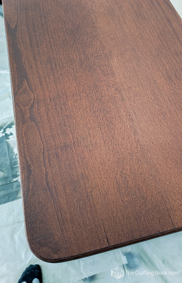 Buffet Top with 3 coats of wood stain showing a rich bold color.