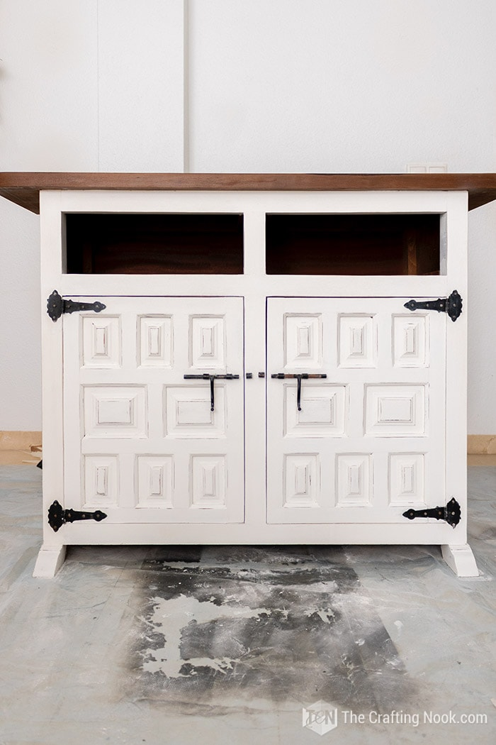 Vintage buffet stained the top with walnut wood stain white chalk paint for the bottom.